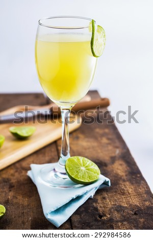 Lime Juice on wooden background