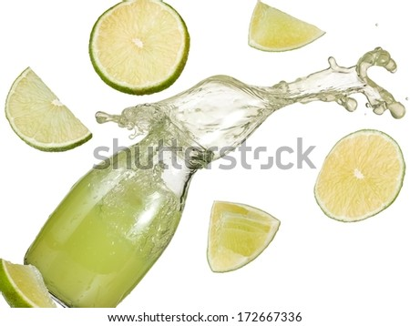 Lime juice splash from a bottle - stock photo