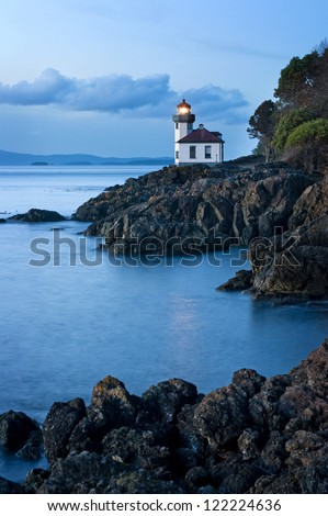 Lime Kiln Lighthouse located on the west coast of San Juan Island in the Puget Sound area of western Washington, USA. The lighthouse faces the Haro Strait just across from Victoria, British Columbia. - stock photo