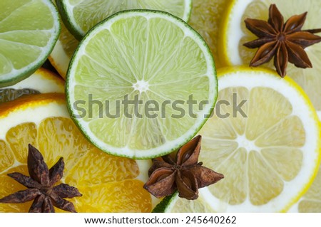 Lime, lemon, orange slices with star anise. - stock photo