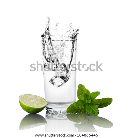 Lime, mint and glass of water  - stock photo