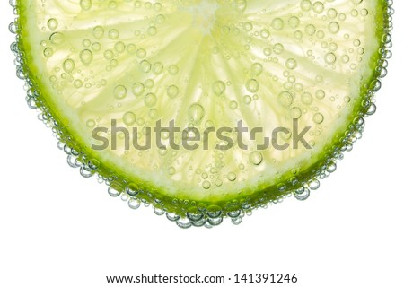 Lime Slice in Clear Fizzy Water Bubble Background Isolated - stock photo