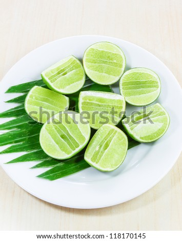 Lime sliced on white plate