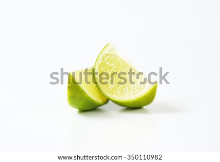 Lime slices on white background - stock photo