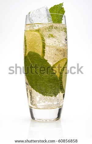 Lime Spritzer Cocktail with lime slices and a mint leaves. - stock photo
