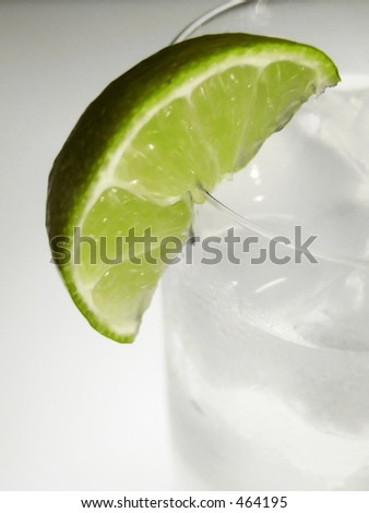 lime wedge on chilled gin and tonic - stock photo