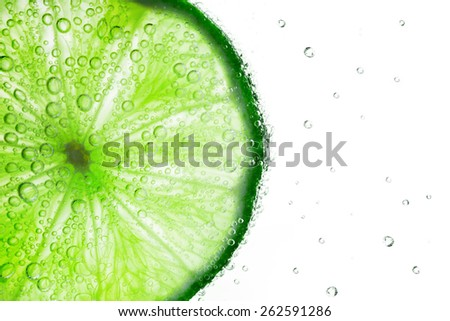 Lime with bubbles of soda isolated on white background - stock photo