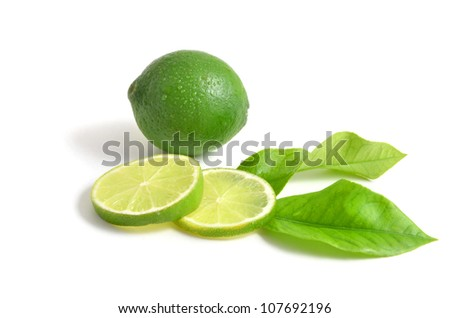 Lime with leaves on white - stock photo