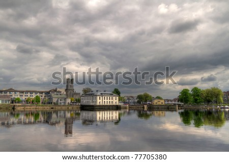 Limerick city hall with reflection in Shannon river - stock photo