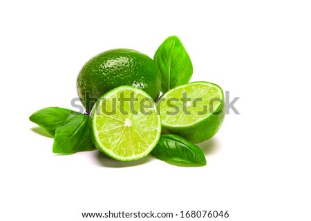 Limes composition One whole lime, two half limes, with leaves, isolated on white - stock photo