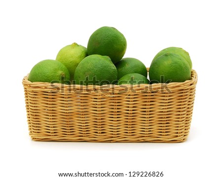 Limes in a basket on white