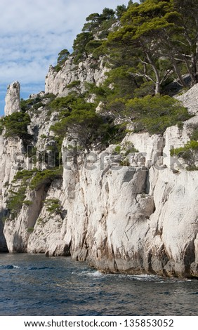 limestone cliffs in a calanque  near Cassis France where tourists rent charter boats to view these inlets - stock photo