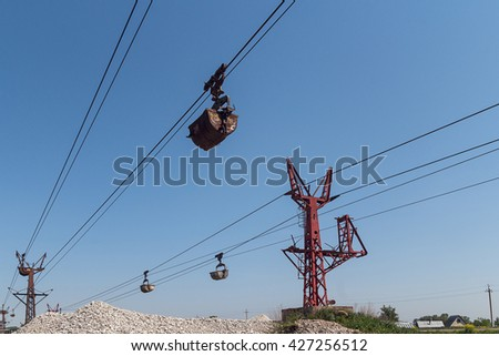 Limestone mining and transportation via cable car. Trolleys carry the mined limestone on the plant for the production of baking soda