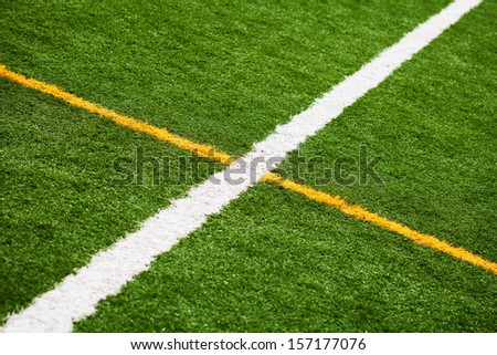 Limit lines of a sports grass field for Background. White and Yellow lines. - stock photo
