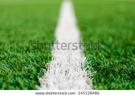 Limit lines of a sports grass field for Background with selective focus