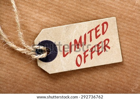 Limited Offer price or luggage tag with string and brown wrapping paper - stock photo