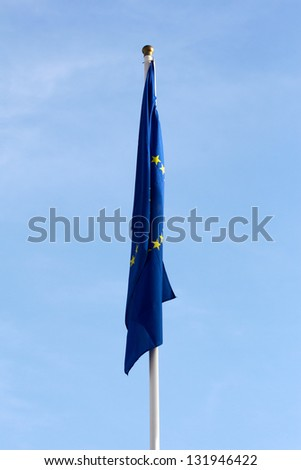 Limp European Union flag without wind  against the blue sky - stock photo