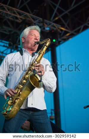 LINCOLN, CA - July 31: Johnny Colla with The News performs with Huey Lewis at Thunder Valley Casino Resort in in Lincoln, California on July 31, 2015