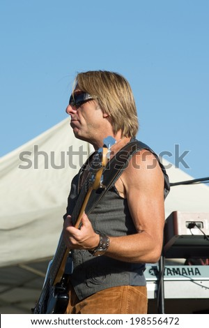 LINCOLN, CA - June 7: Lee Beverly of the Eddie Money Band performs with Eddie Money at Thunder Valley Casino Resort in Lincoln, California on June 7, 2014 - stock photo