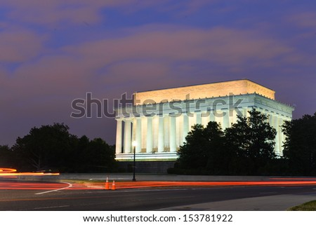 Lincoln Memorial at night with trailing car lights foreground - Washington DC, United States  - stock photo