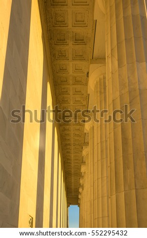 Lincoln's Memorial columns at sunset with warm colors
