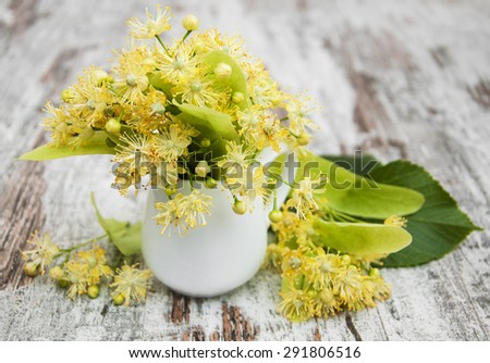 Linden flowers on a old wooden background - stock photo