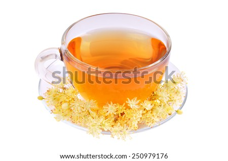 Linden tea in a glass cup on a white background.
