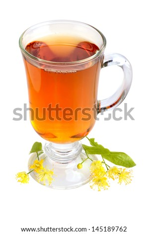 Linden tea in glass cup with fresh linden flowers on a white background