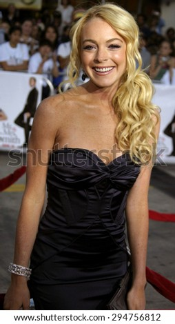 """Lindsay Lohan attends the Los Angeles Premiere of """"Mr. & Mrs. Smith"""" held at the Mann's Village Theater in Westwood, California on June 7, 2005.  - stock photo"""