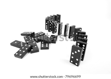 line and pile domino, domino line up curve and a pile of black wooden domino. - stock photo