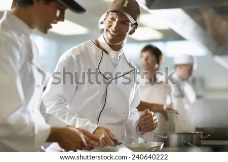 Line Cooks in a Restaurant Kitchen - stock photo