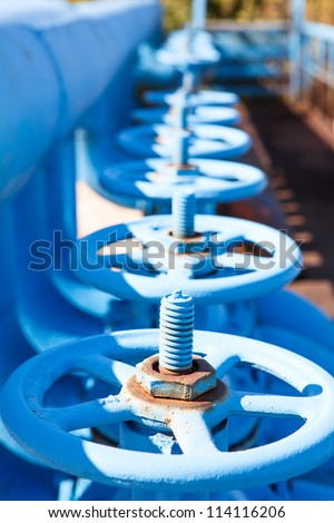 Line from blue vents of oxygen gate valves - stock photo