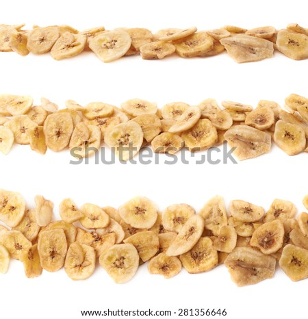 Line made of dried banana slice snacks, composition isolated over the white background