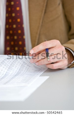 Line Manager with red necktie and pen in his hand