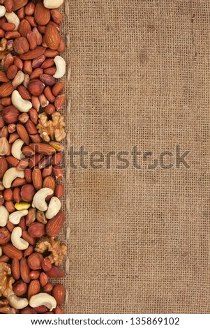 Line, mix nuts  and burlap for the menu, can be used as background - stock photo