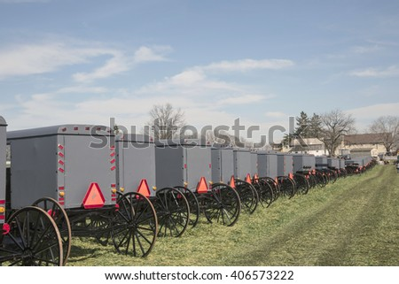 Line of Amish hores drawn buggies.