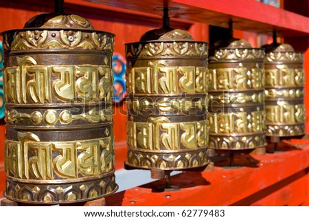 line of buddhist praying drums (written prayers are rolled inside - believers pray rotating drums)