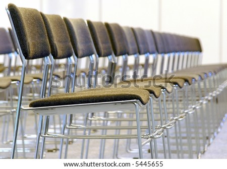 line of chairs with shallow dof - stock photo