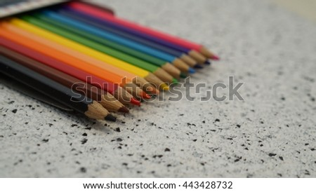line of colored pencils,Color pencil with copy space isolated on whtie and black dot background,education frame concept.Crayons. Colored Pencils. colored pencils on white black background - stock photo