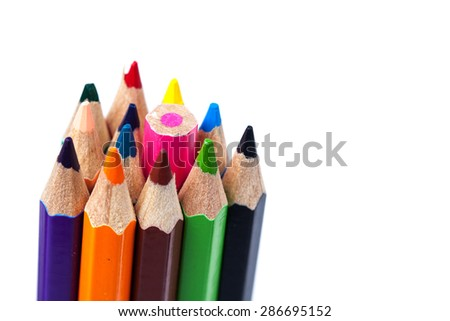 line of colored pencils on white background.