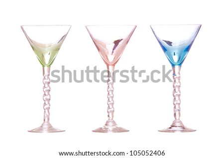 Line of colorful antique martini classes isolated on white - stock photo