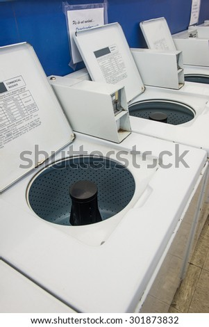 line of commercial laundry machine - stock photo