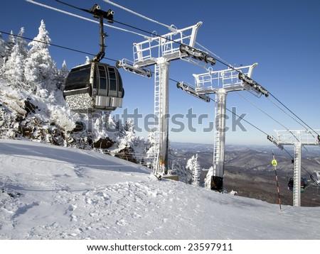 Line of gondolas in a ski resort - stock photo