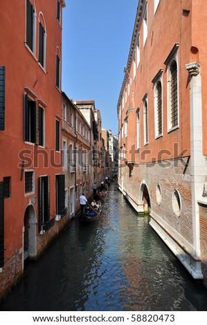 Line of gondolas in Venice, Italy. - stock photo