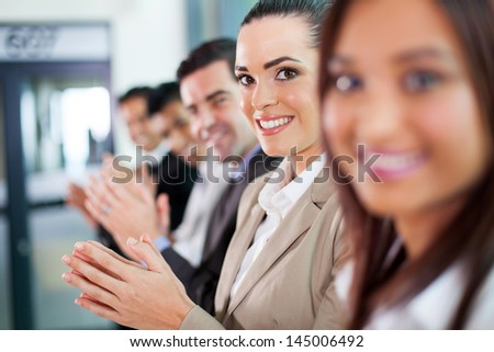 line of group of business people applauding - stock photo