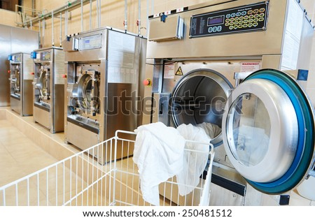 line of industrial laundry machine in laundrette - stock photo