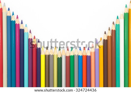 Line of mixed colors wooden pencils on white background - stock photo