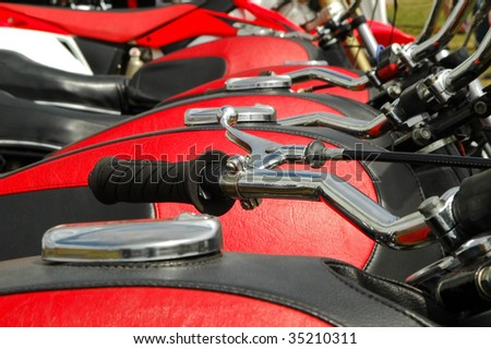line of motorcycles with matching fuel tank covers