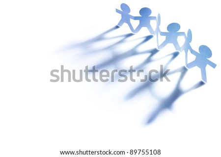 Line of paper doll people holding hands - stock photo