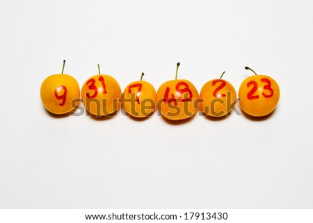 line of  plums with numbers as lottery winners - stock photo